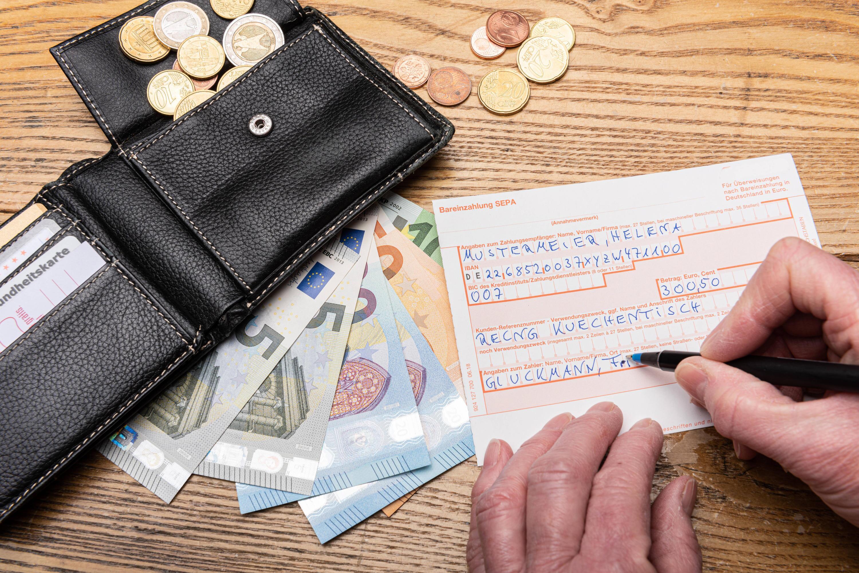 Bild zu Geldbörse, Geldscheine, Überweisungsträger