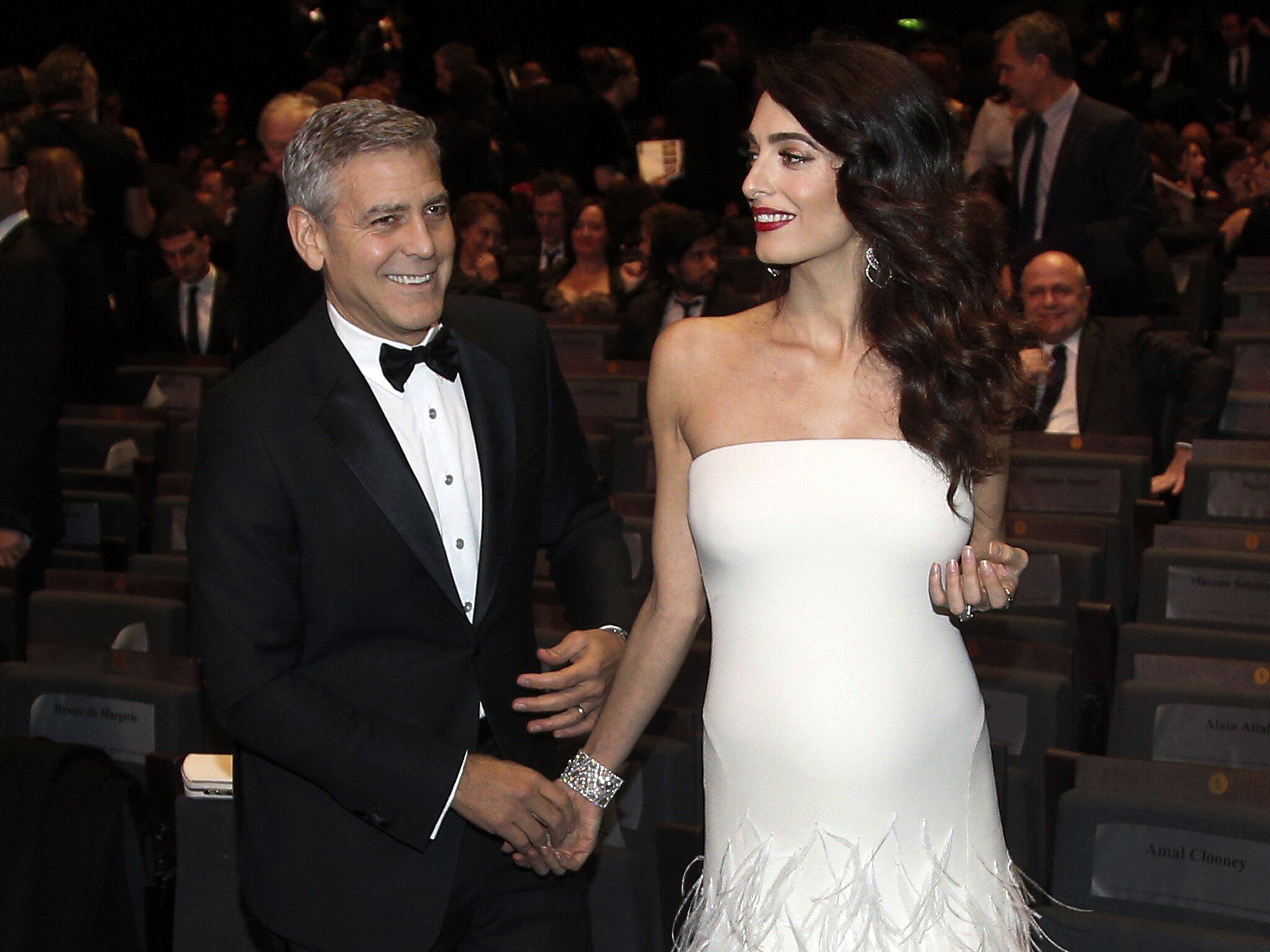 Bild zu Amal Clooney, George Clooney