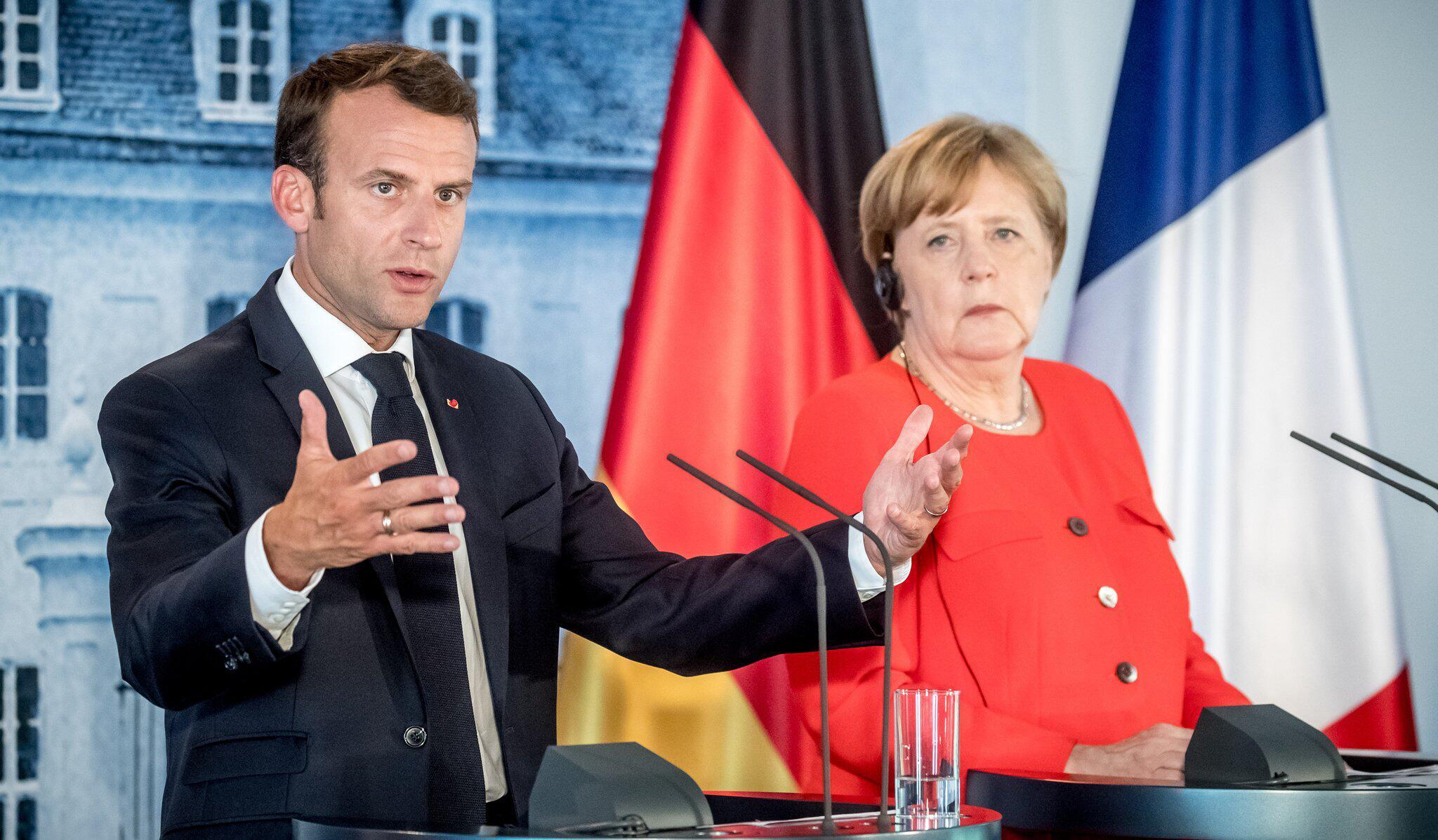 Bild zu Angela Merkel Emmanuel Macron