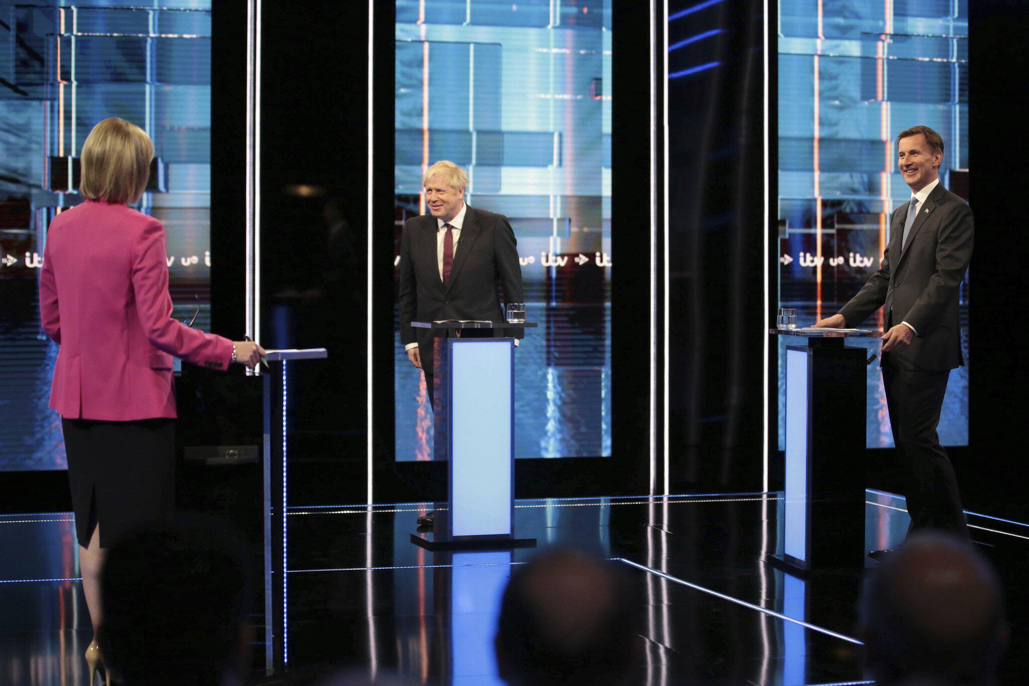 Bild zu Fernseh-Debatte zwischen Johnson und Hunt