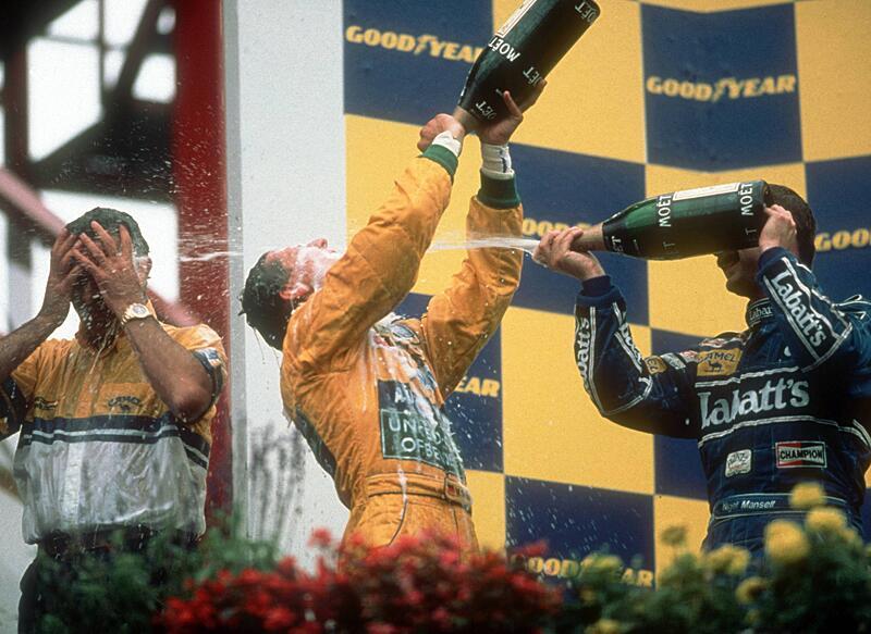 Bild zu Michael Schumacher, Flavio Briatore, Nigel Mansell