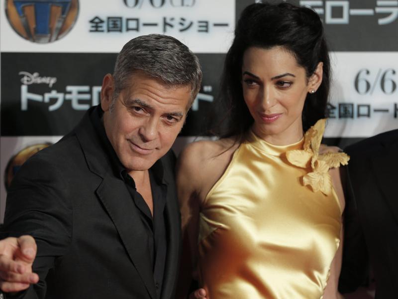 Bild zu George Clooney und Amal Clooney