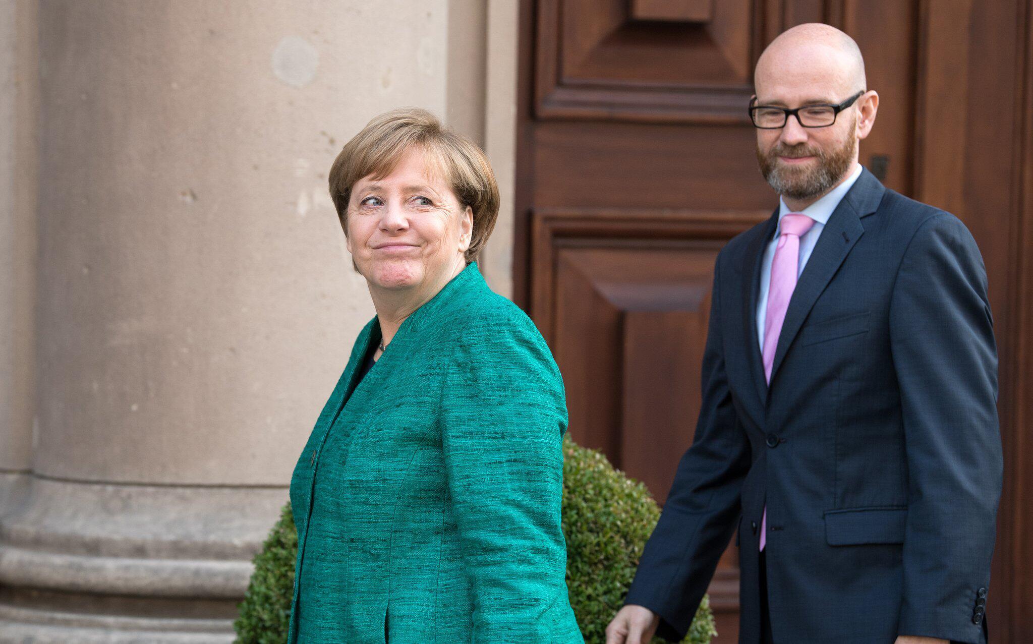 Bild zu Tauber und Merkel